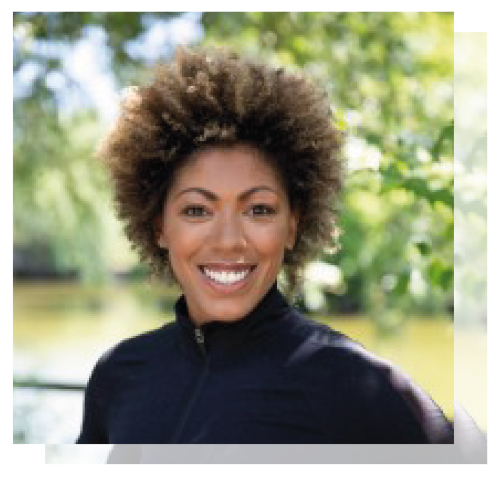 A headshot of Dr Zoe Williams who smiles at the camera wearing a black roll neck sweater