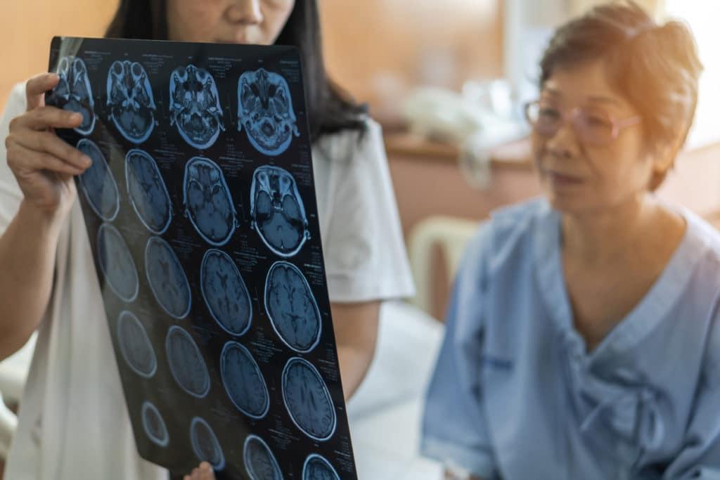 Doctor shows woman patient brain scans